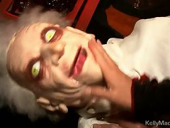 Voluptuous Kelly Madison plays with toys at Halloween