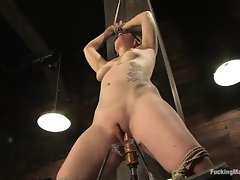 Hot and sexy tattooed girl gets her snatch pumped with a ramming dildo