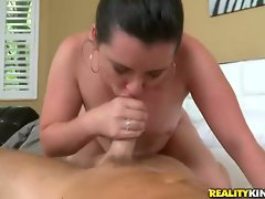 Raunchy milf spreads her lips round a huge fuck shaft