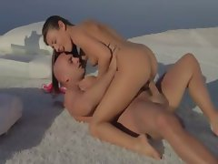 Beautiful lovers copulating by the ocean