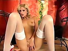 Skinny blonde fingering in white stockings