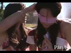 Lesbian teen hotties outdoor in the sun with a dildo toy