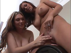 Casandra and Akira ride the sybian