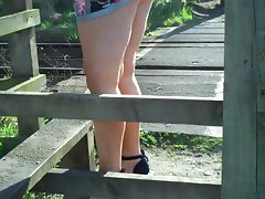 Sexy bare legged milf in high heels and mini dress