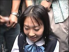 Japanese girl receives a bukkake  in public