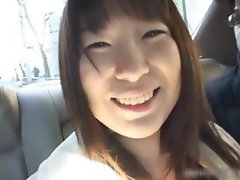 Busty asian having fun in a car