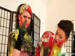 Lesbian slave getting covered in paint