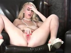 Voluptuous blonde gropes her breasts and plays with her cunt