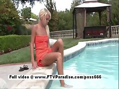 Delightful Naked blonde in the pool