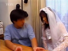 Asian in bride dress touching her body