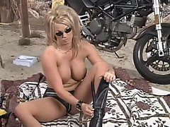 Hot biker chick in leather shorts strips