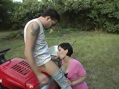 Girl in a pink dress sucks dick outdoors