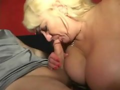 Mature with big knockers gives a BJ