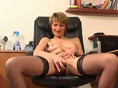 Milf in office with dildo for cunt