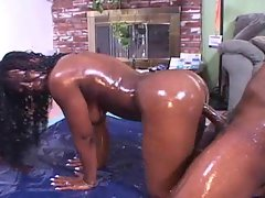 Covered in baby oil and having black sex