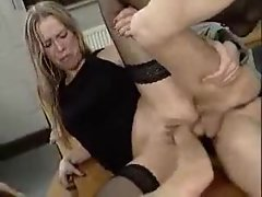 Cum lands in her mouth after they fist her cunt