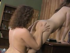 Naughty girls do strapon sex in office