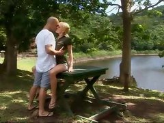 Hot blonde by the lake sitting on a large dick