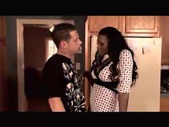 Black milf seduces a young man with a long dick