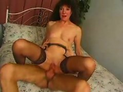 Mature pussy fucked by a big young cock