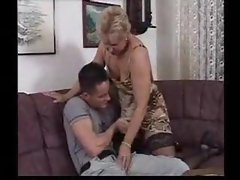 Pumping away at her mature fuck hole