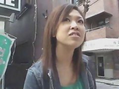 Girl on the street stroking cock in box