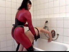 Harsh strapon mistress in leather ass fucks him