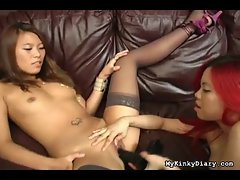 Dildo pushed into the Asian girl wearing stockings