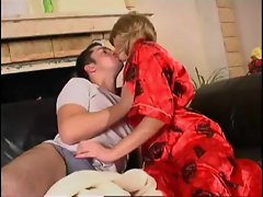 Hot mature in a sexy robe gets fingered