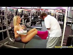 Blonde milf in the gym stripping nude