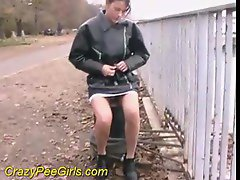 Hottie in a leather jacket pees by the river