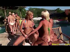 Girls in bikinis having fun at an outdoor party