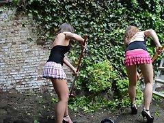 2 lesbians gardening in muddy high heels (+upskirt)