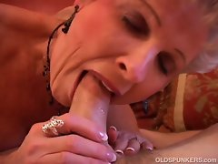Horny granny sucking a big hard cock
