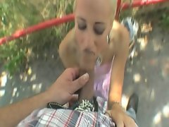 Blonde gives an outdoor cock blow