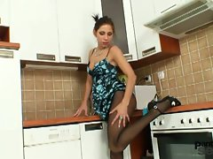 Horny brunette Kira in pantyhose kitchen pussy play