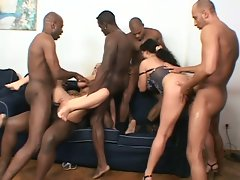 Two white chicks get fucked by a group of black horny men