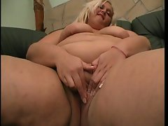 Bbw busty blonde masturbates herself sitting on a sofa!