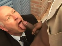 Horny grandpa on his knees sucking and swallowing huge black dick