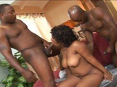 Busty black milf in a hot threesome