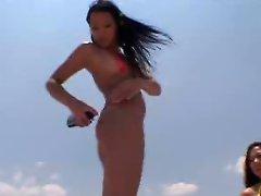 Raquel and Sarah were two hot Asian thong bikini chicks that modeled...