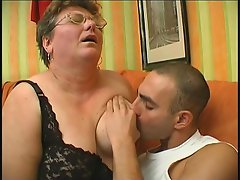 This fat grandma is just raring to go with this young stud. Watch her...