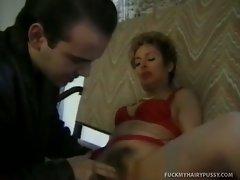This horny MILF loves cock. She invites her neighbor over, since she...
