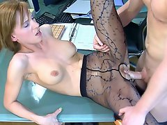 Strict looking babe gets drilled thru patterned tights right in the...