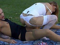 Stocking wearing girl and dick-girl having a butt-fucking picnic...