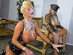 Sharon Pink and her friend are dressed in some kinky gear and are...