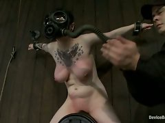 Tightly bound big tits rides the sybian. The mouth makes noises, the...