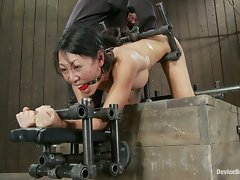 Tiny hot Asian MILF get bound in metal and ASS fucked by a brutal...
