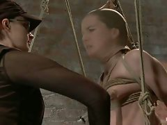 In part 3 of AnnaBelle's Live Show, she is bound to the cruel wooden...