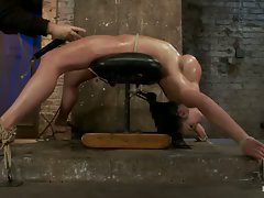 Cute girl with massive tits is severely bound arched, oiled. Pussy...